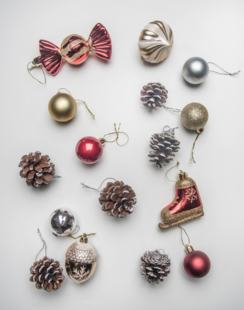 Christmas concept, Christmas toys laid out on a white background, space for text