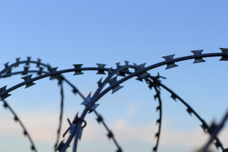 a barbed wire and the sky Stock Photo - 18089805