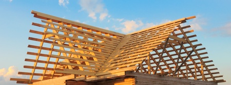 Wooden roof frame and the blue sky photo