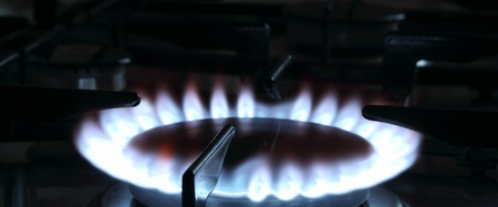 Blue flame of a natural gas on a kitchen gas stove photographed  in a low key Stock Photo - 18089361