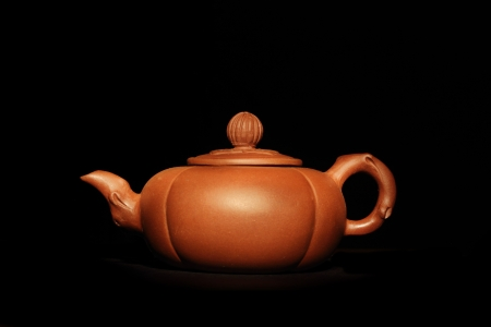 chinesse: Chinesse brown clay teapot on a dark background