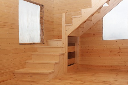 Wooden loft stairs in the timber house corner under conctruction photo