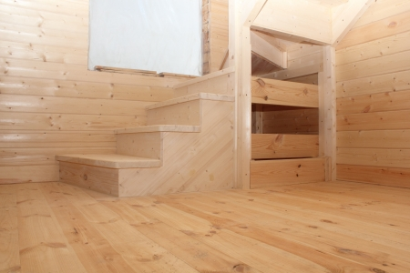 Wooden loft stairs in the timber house under conctruction photo