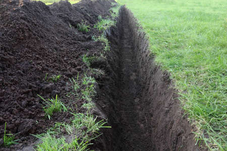 open trench: Trench in the ground at the lawn closeup