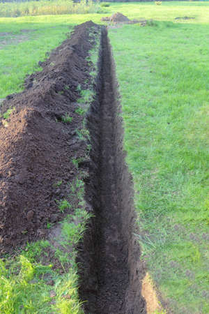 open trench: Trench in the ground at the green lawn