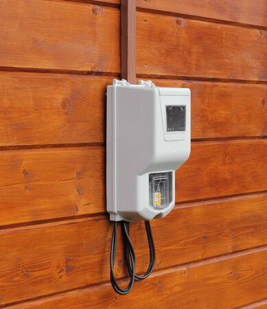 electricity supply: Electricity supply meter mounted on wooden wall