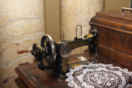 stitching machine: Vintage black sewing machine left view photo