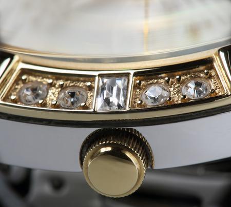winder: Gold clock winder extreme closeup photo