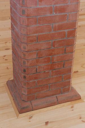 Brick chimney going straight up through the floor photo photo