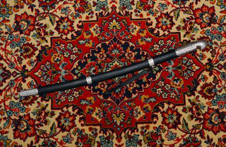 cavalry: Circassian cavalry sword  in a sheath on the carpet photo Stock Photo