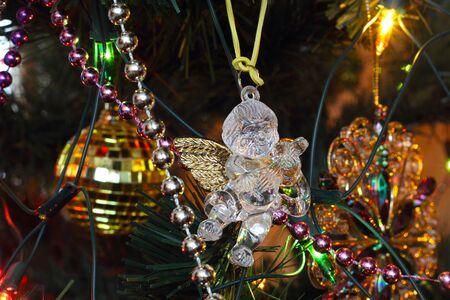 festoon: Christmas tree decorations - transparent plastic angel photo Stock Photo