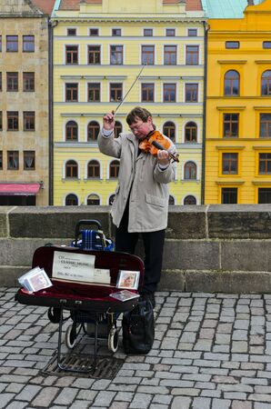 symphonic: Street musician. The sounds of symphonic music. Violin