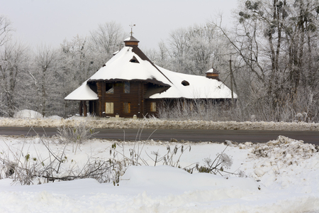 Unfinished house standing near the winter road Stock Photo