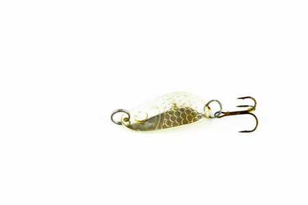 Exhibition of pirated copies of fishing metal spoon baits. Bait for fishing in the shape of a spoon with a hook on a white background