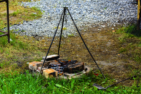 Cooking on a fire in the open air, fire, stand on three supports under the pot