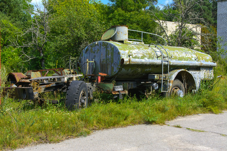 Abandoned rusty container for combustible materials. Dead military unit. Consequences of the Chernobyl nuclear disaster, August 2017.