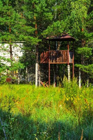 The abandoned building of the guard tower for soldiers. Dead military unit. Consequences of the Chernobyl nuclear disaster, August 2017. Stock Photo