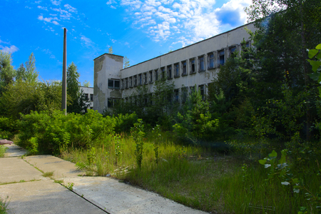 An old abandoned road in the exclusion zone. Dead military unit. Consequences of the Chernobyl nuclear disaster, August 2017.