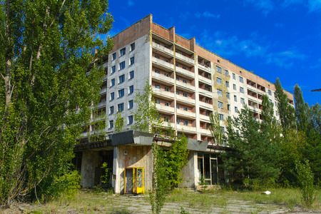 Old abandoned high-rise buildings in a dead radioactive zone. Looting and vandalism. Consequences of the Chernobyl nuclear disaster, August 2017. Editorial