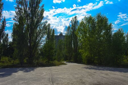 Old abandoned high-rise buildings in a dead radioactive zone. Looting and vandalism. Consequences of the Chernobyl nuclear disaster, August 2017. Stock Photo