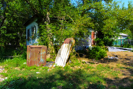 urban decay: Destroyed houses in which people lived in a dead radioactive zone. Consequences of the Chernobyl nuclear disaster and vandalism, August 2017.