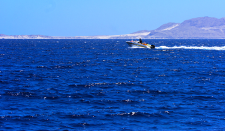 Sharm el-Sheikh, Egypt - March 14, 2018. A magnificent snow-white motor boat in the Red Sea against a blue sky near the unique Ras Mohammed nature reserve. Magnificent diving, summer, vacation.