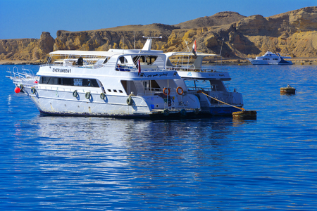 Sharm el-Sheikh, Egypt - March 14, 2018 Luxurious white motor yacht in the Red Sea against the blue sky of old coral reefs of the unique Ras Mohammed nature reserve, diving, summer, vacation.