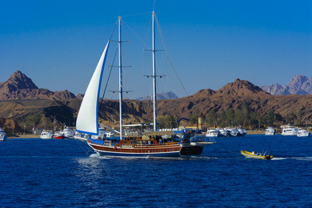 Sharm el-Sheikh, Egypt - March 14, 2018 A luxurious wooden sailboat in the Red Sea against the blue sky of old coral reefs of the unique Ras Mohammed nature reserve, diving, summer, vacation. Editorial