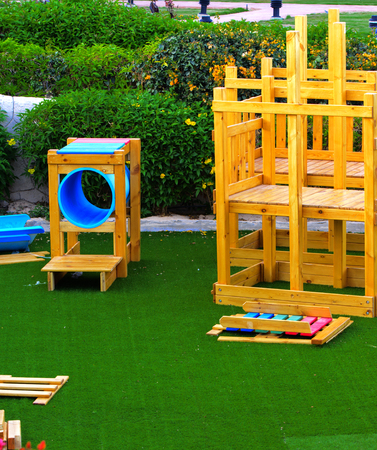 Sharm el-Sheikh, Egypt - March 14, 2018. Childrens wooden multi-colored game constructions on a background of green artificial grass. Accommodation in Cyrene Grand Hotel