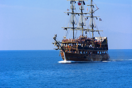 Alanya, Turkey - October 05, 2018. A large sailing ship in a pirate style in the open sea against a blue sky. Photos of the ship from the sea. The concept of summer holidays, sports, tourism Editorial