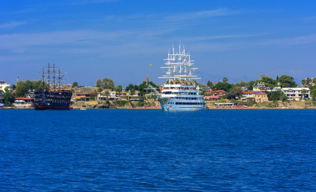 Alanya, Turkey - October 05, 2018. A large sailing ship in a pirate style is moored near the coast against a blue sky. Photos of the ship from the sea. The concept of summer holidays, sports, tourism