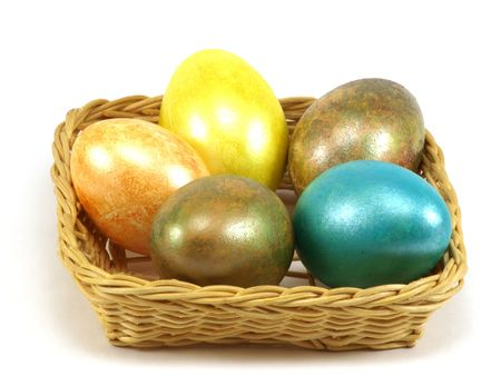 Five Easter eggs to a basket isolated on a white background       photo