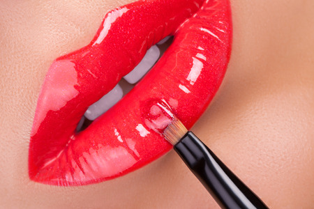 gloss: Red gloss lips. Beautiful red lips close-up.
