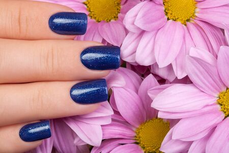 nails: Beautiful nails and blue flower.