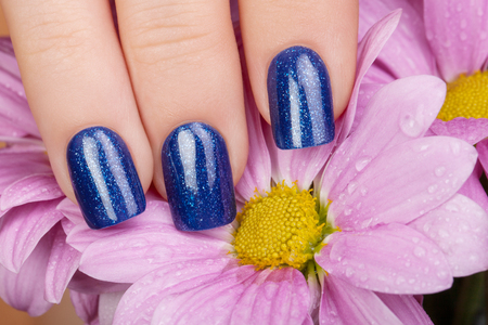Beautiful nails and blue flower.