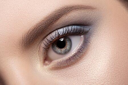 blue eye: Colorful eye makeup closeup. Stock Photo