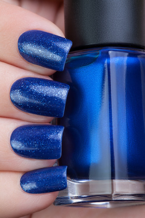 polish: Beautiful blue nails.