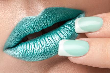 gloss: Turquoise lip gloss and a beautiful nails.