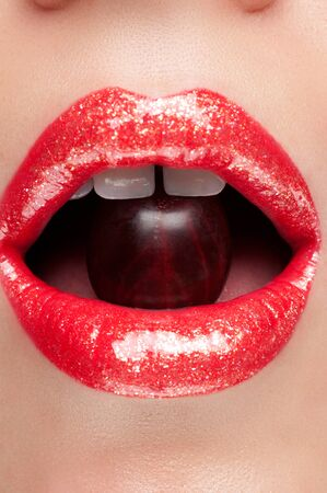gloss: Lip gloss with red berries Stock Photo