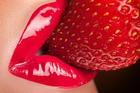 Lips with red glitter and strawberries.