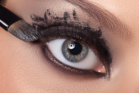 black eye: Black eye makeup closeup. Make-up colors aqua make-up done.