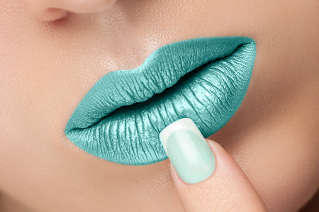 gloss: Turquoise lip gloss and a beautiful nails.