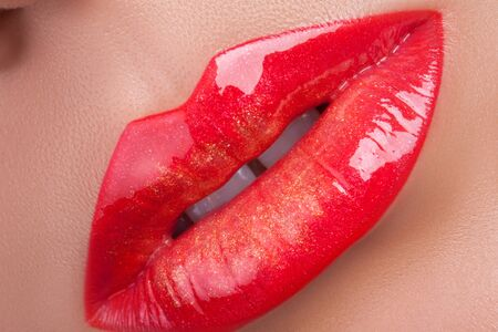 Red gloss lips. Beautiful red lips close-up.