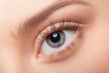 female eyes: Natural eye makeup closeup.