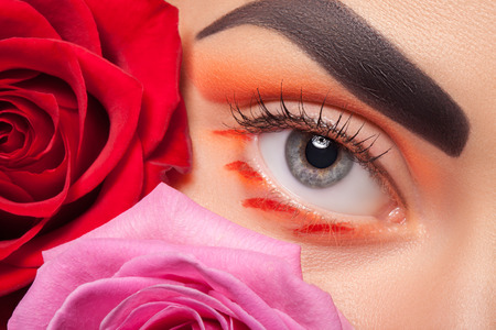 eye for an eye: Colorful eye makeup on the background color. A good idea for the advertising of cosmetics.