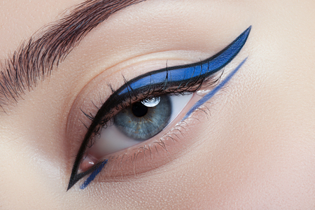 makeup fashion: Colorful eye makeup closeup. Stock Photo