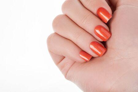 Orange nails on a white background with fruit.