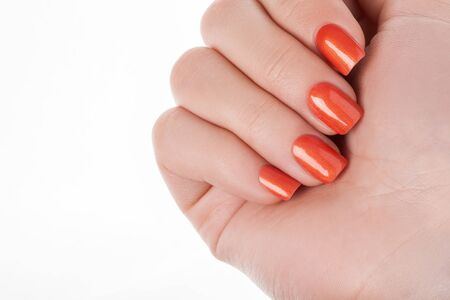 nail lacquer: Orange nails on a white background with fruit.