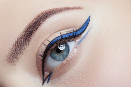 Colorful eye makeup closeup. Stock Photo