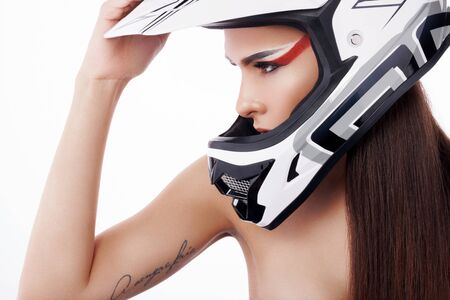 motorized sport: Beautiful girl with makeup in a helmet. Stock Photo